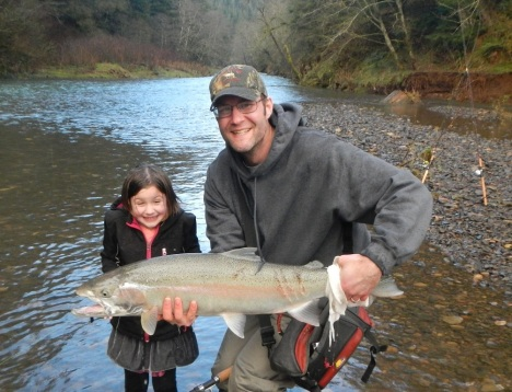 Luke Kralik fishing with one of his daughters