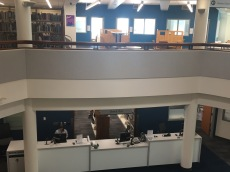 Photograph of Check Out Desk viewed from floating mezzanine