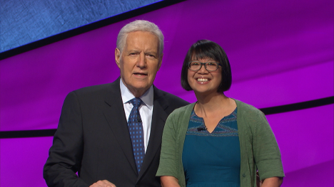 Photo of Veronica Vichit-Vadakan with Alex Trebek